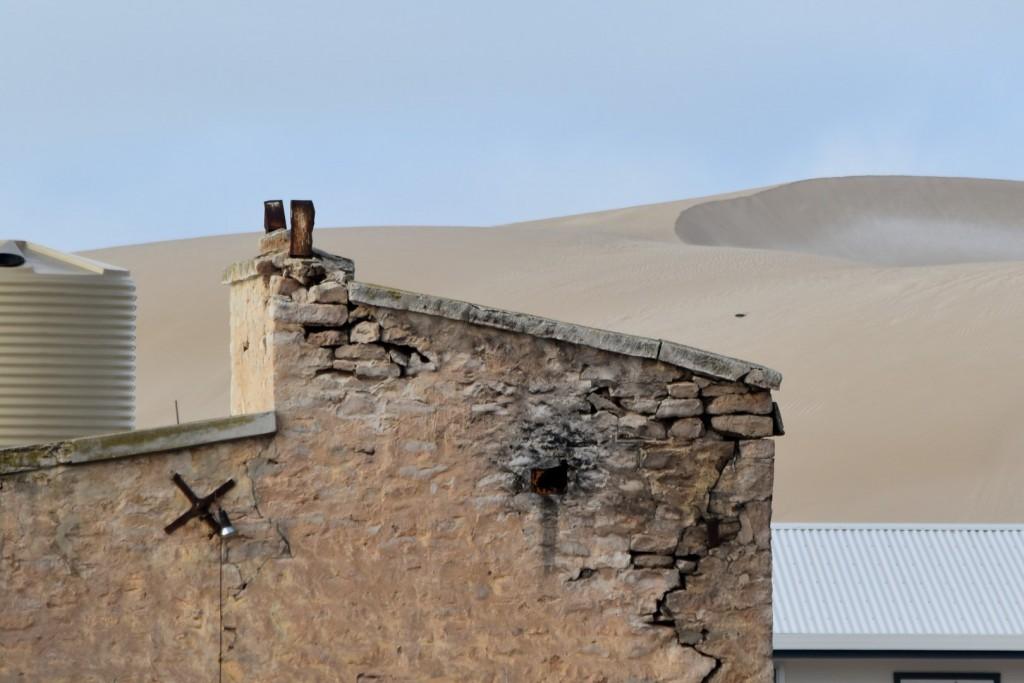 Threatening sand dunes